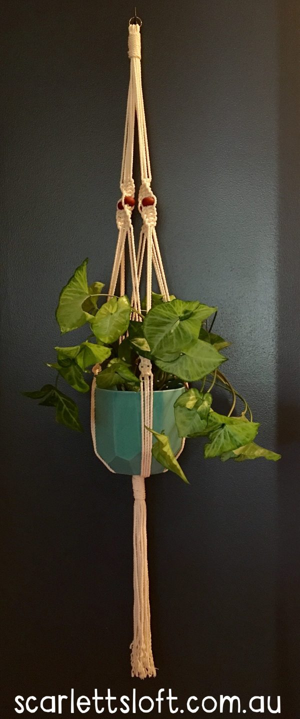 Large handmade macrame hanger with brown beads.
